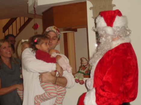 Faith and Daddy meeting Santa