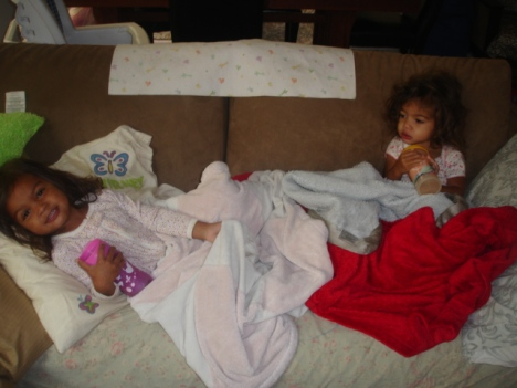 """Journey and Faith laying in """"sick bed"""""""
